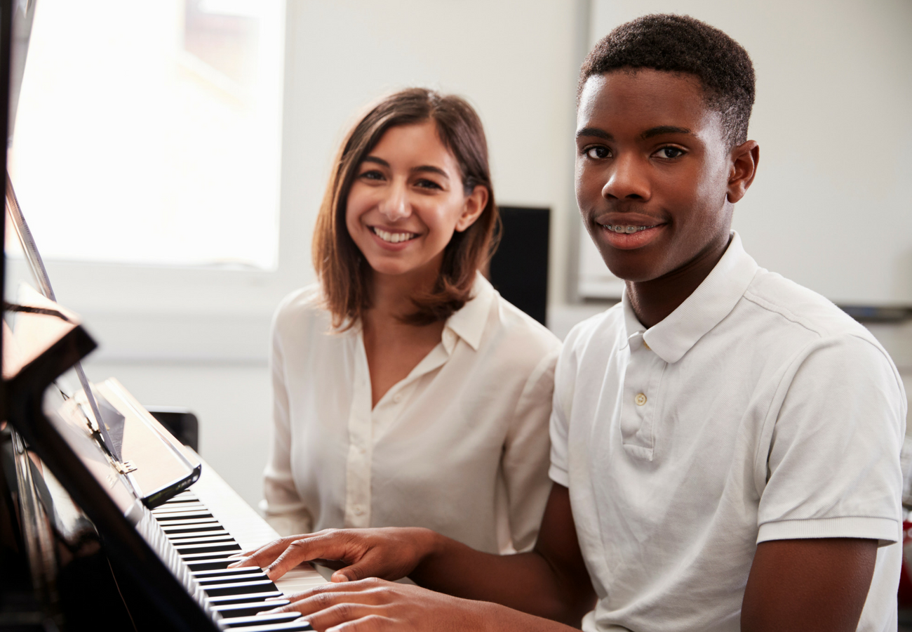 Smiling Student Playing Piano